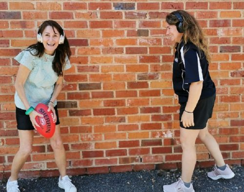 Rachael and Felicity playing footy